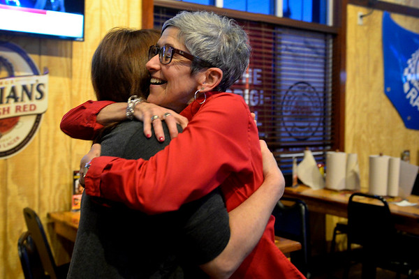 BEN MIKESELL | THE GOSHEN NEWS<br /> Goshen High School principal Diane Woodworth hugs Val Collins, Goshen, during a watch party at Wings Etc. in Goshen after both parts of the Goshen Community Schools referendum passed Tuesday evening.