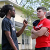 GEOFF LESAR | THE GOSHEN NEWS<br /> <br /> J.D. Hamilton, left, of South Bend, and Joe (would not give his last name), of South Bend, debate and exchange points ahead of President Donald Trump's visit to Elkhart Thursday evening.