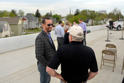 BEN MIKESELL   THE GOSHEN NEWS Mayor Jeremy Stutsman talks with former mayor Allan Kauffman before the ribbon-cutting ceremony for the U.S. 33 North Connector route above Lincoln Avenue in Goshen.