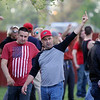 GEOFF LESAR | THE GOSHEN NEWS<br /> <br /> A man offers his middle finger to a crowd of protesters Thursday evening following President Donald Trump's arrival in Elkhart.