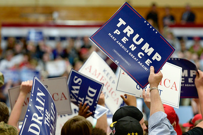 BEN MIKESELL   THE GOSHEN NEWS The crowd holds up signs before President Donald Trump's rally Thursday at North Side Gym in Elkhart.