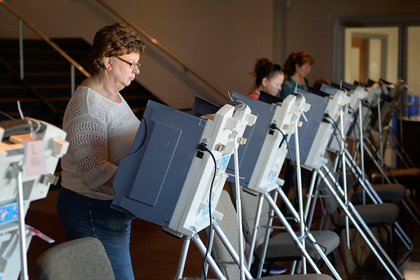 BEN MIKESELL   THE GOSHEN NEWS<br /> Jane Schneider, Goshen, casts her ballot during the primary election Tuesday at Grace Community Church in Goshen.