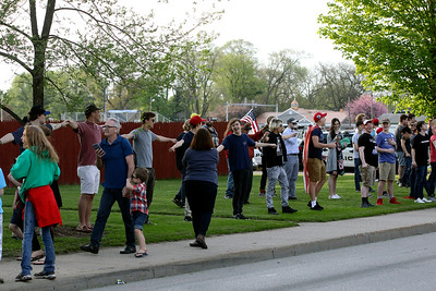 """GEOFF LESAR   THE GOSHEN NEWS  Supporters of President Donald Trump stretch arms while chanting, """"Build the wall,"""" following the arrival of Trump at North Side Middle School Thursday evening in Elkhart."""