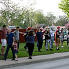 "GEOFF LESAR | THE GOSHEN NEWS<br /> <br /> Supporters of President Donald Trump stretch arms while chanting, ""Build the wall,"" following the arrival of Trump at North Side Middle School Thursday evening in Elkhart."