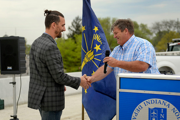 BEN MIKESELL | THE GOSHEN NEWS<br /> Indiana sen. Blake Doriot shakes hands with Mayor Jeremy Stutsman as he introduces him during the U.S. 33 North Connector Route ribbon-cutting Wednesday above Lincoln Avenue in Goshen.