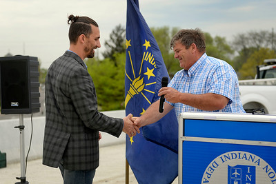 BEN MIKESELL   THE GOSHEN NEWS Indiana sen. Blake Doriot shakes hands with Mayor Jeremy Stutsman as he introduces him during the U.S. 33 North Connector Route ribbon-cutting Wednesday above Lincoln Avenue in Goshen.