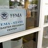 BEN MIKESELL | THE GOSHEN NEWS<br /> People enter the Elkhart County Health Department, where the Federal Emergency Management Agency (FEMA) has set up a Disaster Recovery Center Friday in Elkhart.