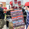 BEN MIKESELL | THE GOSHEN NEWS<br /> Carl Gold, Cleveland, Ohio, walks down Emerald Street trying to sell Donald Trump pins before the President's rally at North Side Gym in Elkhart.