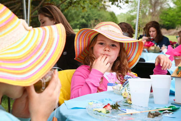 LEANDRA BEABOUT   THE GOSHEN NEWS<br /> Hailee Hogan, 4, of Goshen, enjoyed her tea and snacks at the SPA Women's Ministry tea party.