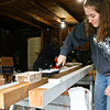 LEANDRA BEABOUT | THE GOSHEN NEWS<br /> Elena Meyer Reimer of Goshen paints porch posts for LaCasa's annual Help a House day.