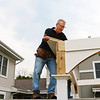 LEANDRA BEABOUT | THE GOSHEN NEWS<br /> Pete Miller helps build a gazebo at West Plains Apartments for LaCasa's annual Help a House event.