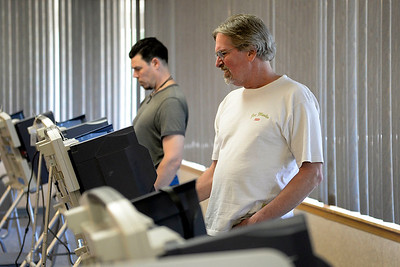 BEN MIKESELL   THE GOSHEN NEWS Richard Ambrosen, right, Goshen, casts his ballot on the machine during the Primary Election Tuesday at the Salvation Army in Goshen.