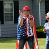 GEOFF LESAR | THE GOSHEN NEWS<br /> <br /> Justin Utley, of Elkhart, sports a Budweiser shirt and American flag as a cape while waiting in line to enter President Donald Trump's rally Thursday evening at North Side Middle School in Elkhart.