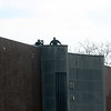 GEOFF LESAR | THE GOSHEN NEWS<br /> <br /> Protective detail survey their surroundings atop of North Side Middle School Thursday evening ahead of President Donald Trump's visit.