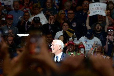 BEN MIKESELL   THE GOSHEN NEWS Vice President Mike Pence speaks at the podium during President Donald Trump's rally Thursday night at North Side Gym in Elkhart, Indiana.