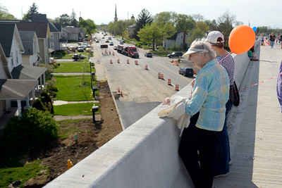 BEN MIKESELL   THE GOSHEN NEWS Kathyrn Aschliman, Goshen, looks over the edge of the U.S. 33 North Connector route during the public bridge walk Wednesday evening in Goshen. For one hour, the community was allowed to tour the bridge before it opens in a week and a half.