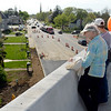 BEN MIKESELL | THE GOSHEN NEWS<br /> Kathyrn Aschliman, Goshen, looks over the edge of the U.S. 33 North Connector route during the public bridge walk Wednesday evening in Goshen. For one hour, the community was allowed to tour the bridge before it opens in a week and a half.