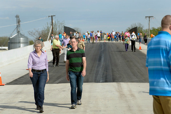 BEN MIKESELL | THE GOSHEN NEWS<br /> People make their way up the new U.S. 33 North Connector route during the bridge walk Wednesday in Goshen. For one hour, the community was allowed to tour the new road before it opens next week.