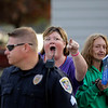 GEOFF LESAR | THE GOSHEN NEWS<br /> <br /> A woman verbally spars with protesters across the street Thursday evening following President Donald Trump's arrival in Elkhart.