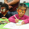 BEN MIKESELL | THE GOSHEN NEWS<br /> Amelia Medina, 4, of Elkhart, right, draws on a skull-shaped cookie with Jordan Miguel Hernandez, 4, of Goshen, during the third annual Day of the Dead celebration at Ivy Tech in Goshen.