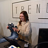 BEN MIKESELL | THE GOSHEN NEWS<br /> Keirsten Miller, co-owner of Trend Clothing, folds up jeans during the opening day of the new store in Linway Plaza in Goshen.