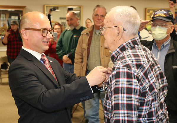 JOHN KLINE | THE GOSHEN NEWS<br /> Guillaume Lacroix, consul general of France based out of Chicago, Illinois, left, awards World War II veteran Dan Levernier, 95, of Milford, with the French Legion of Honor — France's highest honor — during a ceremony Monday at the Milford Community Building.