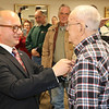 JOHN KLINE   THE GOSHEN NEWS<br /> Guillaume Lacroix, consul general of France based out of Chicago, Illinois, left, awards World War II veteran Dan Levernier, 95, of Milford, with the French Legion of Honor — France's highest honor — during a ceremony Monday at the Milford Community Building.