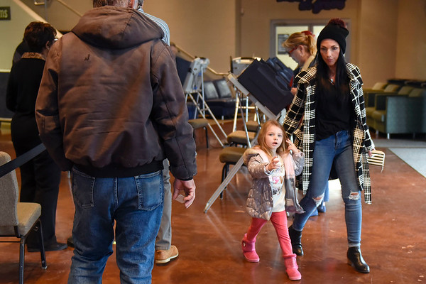 BEN MIKESELL | THE GOSHEN NEWS<br /> Brooke Evans and her daughter Kate, 4, both of Goshen, leave the polling machines Tuesday at Grace Community Church.