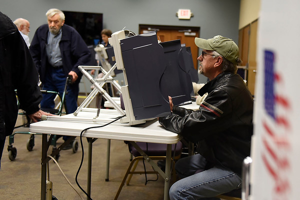 BEN MIKESELL | THE GOSHEN NEWS<br /> Larry Howard, of Goshen, casts his votes in the midterm election Tuesday at Greencroft Goshen.
