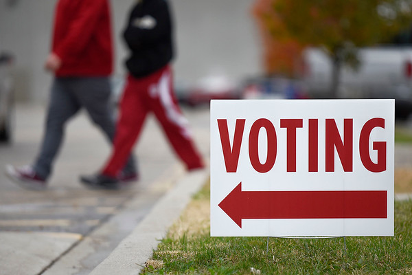 BEN MIKESELL | THE GOSHEN NEWS<br /> People head toward the voting stations to vote in Tuesday's midterm election at Maple City Chapel in Goshen.