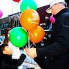 SHEILA SELMAN | THE GOSHEN NEWS<br /> Emiliano Palacios, 7, Goshen, picks a balloon from the bundle Don Jantzi, Goshen, representing Triple P, was passing out during Goshen's First Fridays.