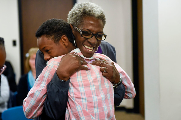 BEN MIKESELL | THE GOSHEN NEWS<br /> Mary Brown, of Elkhart, embraces her new great-nephew Lindani Logan, 12, after he was adopted by Rita McKinney Friday morning at the Elkhart County Juvenile Court in Elkhart. Brown took care of Logan since he was four-years-old.