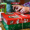 BEN MIKESELL | THE GOSHEN NEWS<br /> Operation Christmas Child boxes are prepared by volunteers to be shipped Tuesday at Clinton Frame Church.