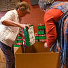 BEN MIKESELL | THE GOSHEN NEWS<br /> Pat Yoder, Operation Christmas Child committee member, works with volunteer Jane Borntrager to pack boxes Tuesday to Clinton Frame Church.