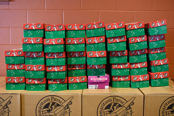 BEN MIKESELL | THE GOSHEN NEWS<br /> Operation Christmas Child boxes are stacked along the wall Tuesday inside Clinton Frame Church.
