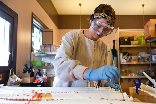 BEN MIKESELL | THE GOSHEN NEWS<br /> Jacie Smeltzer adds swirls to the mixture of Sandalwood and Myrrh soap Tuesday afternoon at the Soapy Gnome in downtown Goshen.