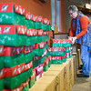 BEN MIKESELL | THE GOSHEN NEWS<br /> Volunteer Jane Borntrager prepares Operation Christmas Child boxes to be shipped Tuesday at Clinton Frame Church on C.R. 35.