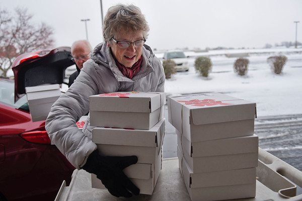 BEN MIKESELL | THE GOSHEN NEWS<br /> Jane Detweiler, Goshen, delivers boxes for Operation Christmas Child Thursday afternoon at Clinton Frame Church on C.R. 35. Volunteers at the church are accepting donations for the Operation Christmas Child until next Monday, which will then be sent to Niles, Michigan, and distributed across the world.