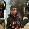 BEN MIKESELL | THE GOSHEN NEWS<br /> Chris Hoel speaks to firefighters after helping his neighbor Cesar Perez out of his burning home Monday on Wilkinson Street. Hoel went into the burning building to help Perez look for any of his children who may have been in the home, and he came out with minor burns on his face.