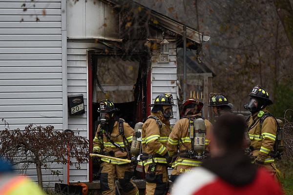 BEN MIKESELL | THE GOSHEN NEWS<br /> Firefighters prepare to enter Cesar Perez's home at 205 W Wilkinson St. to battle a fire Monday afternoon.
