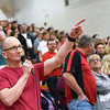 "BEN MIKESELL | THE GOSHEN NEWS<br /> Thad Hart, first-grade teacher at Shipshewana-Scott Elementary School, sings ""Sweet Caroline"" at the beginning of Westview's season-opening game against Bethany Christian Tuesday night."