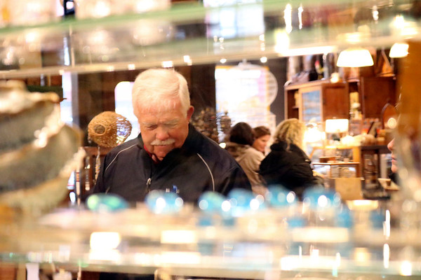SHEILA SELMAN | THE GOSHEN NEWS<br /> Dermot McCarthy, Warsaw, peruses items at Found in downtown Goshen during Shop Small Business Saturday.