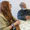 "Roger Schneider | The Goshen News<br /> Julie Kramer listens to William ""Wink"" Rugg talk about what it has been like living outside in Goshen for nearly nine years. Kramer and her husband Robert are among the growing number of people advocating for a homeless shelter for Goshen."