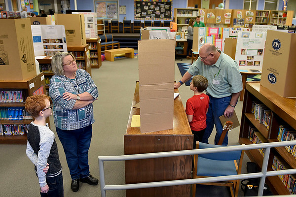 BEN MIKESELL | THE GOSHEN NEWS<br /> Volunteer judges listen to students explain their science fair project Thursday morning at Ox Bow Elementary School.