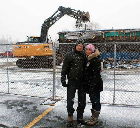 Roger Schneider | The Goshen News<br /> Denny Yoder, former owner, and Heather Tobias Harren, current co-owner of The Oasis bar and restaurant in Goshen, stand near the building Monday morning as it is torn down to make way for a new building.
