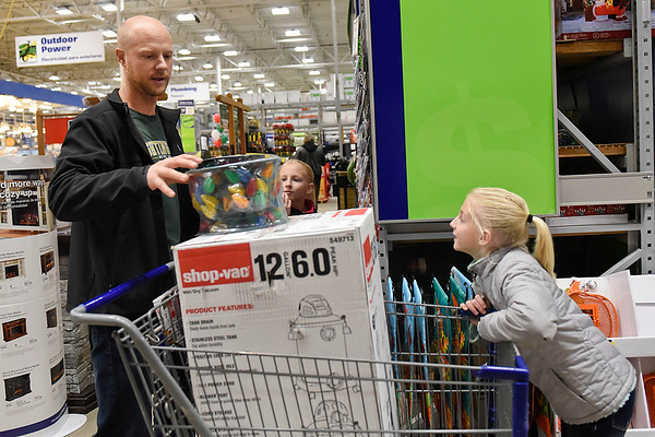 BEN MIKESELL | THE GOSHEN NEWS<br /> Vern Miller, of Goshen, shops with his three daughters Nicole, 9, pictured on the right, Callie, 9, and Natalie, 5, on Black Friday inside Lowe's. Miller said his wife Angie went shopping at midnight, so he took their daughters out in the morning so she could sleep.