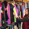 AIMEE AMBROSE | THE GOSHEN NEWS <br /> Trisha Handrich, Goshen, looks at shirts on a rack at Twice as Nice consignment shop in downtown Goshen as part of the Small Business Saturday event on Saturday.
