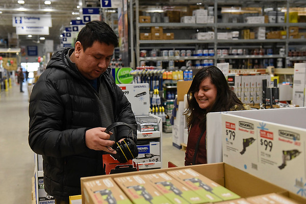 BEN MIKESELL | THE GOSHEN NEWS<br /> Oscar Cuatepotzo and his daughter Summer, 16, shop for deals Friday morning inside Lowe's.