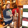 SHEILA SELMAN | THE GOSHEN NEWS<br /> Christyn Connolly, Goshen, inspects some of the merchandise at Found in downtown Goshen during Shop Small Business Saturday.