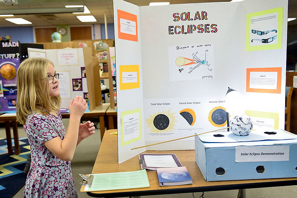 BEN MIKESELL | THE GOSHEN NEWS<br /> Third-grader Alyssa Mascola demonstrates how her solar eclipse experiment works Thursday morning at Ox Bow Elementary School.